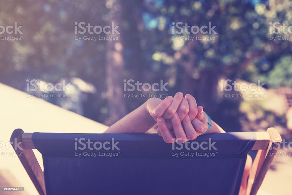 Woman relaxing in deck chair stock photo