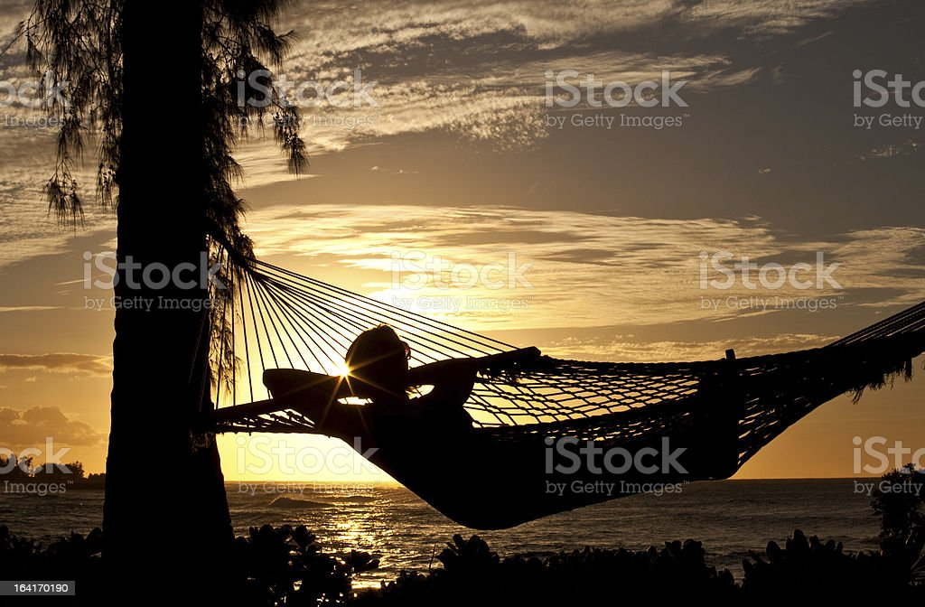 Woman Relaxing in Hammock on the Beach royalty-free stock photo
