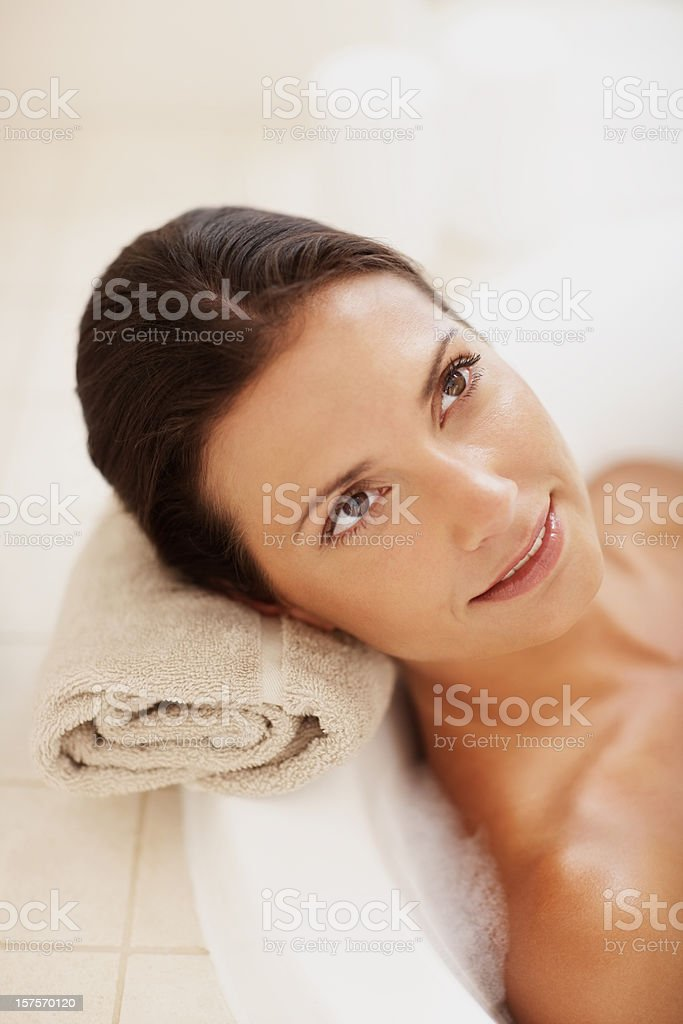 Woman relaxing in her bath tub royalty-free stock photo