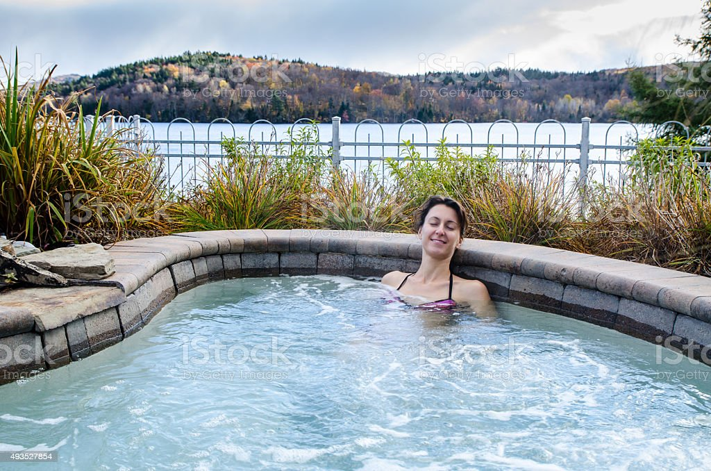 Woman relaxing in her outside spa stock photo