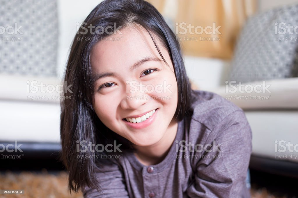 Woman Relaxing in Living Room stock photo