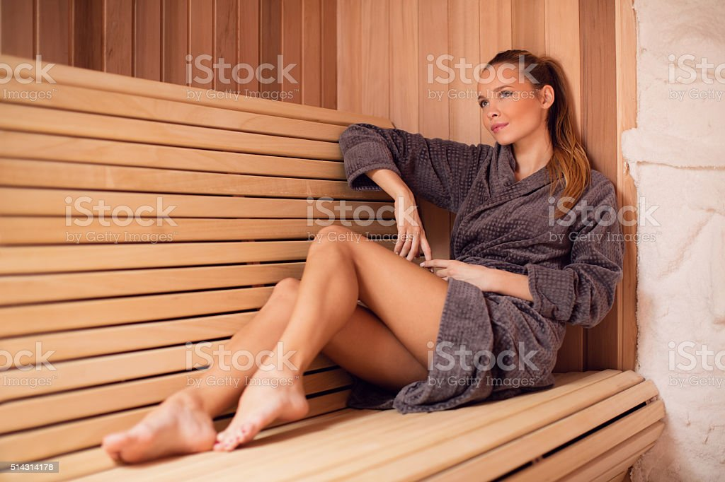 Woman relaxing in salt room and enjoying in halotherapy treatmen stock photo