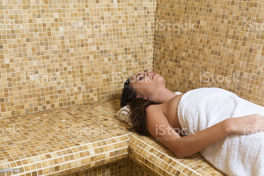 Woman relaxing in steam sauna royalty-free stock photo