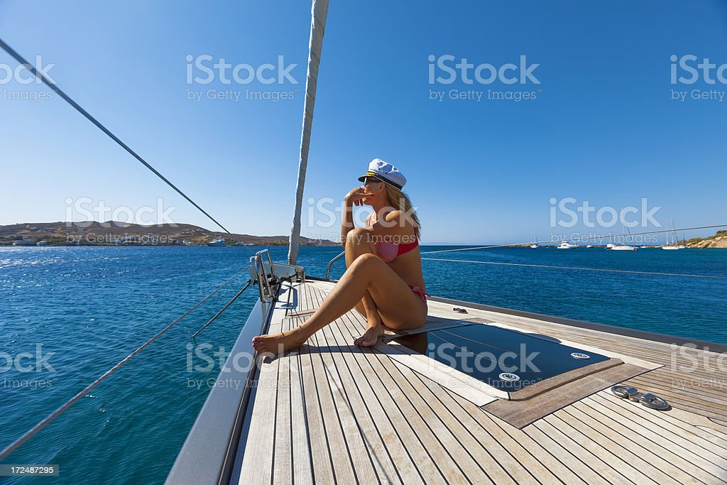 Woman relaxing in sunshine on the  sailing ship royalty-free stock photo