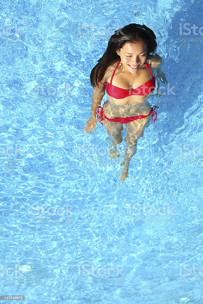 Woman relaxing in swimming pool royalty-free stock photo