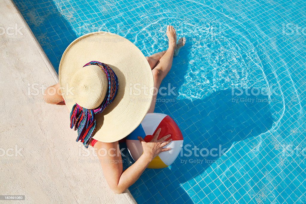 Woman Relaxing in Swimming Pool with Beachball on Summer Vacation royalty-free stock photo