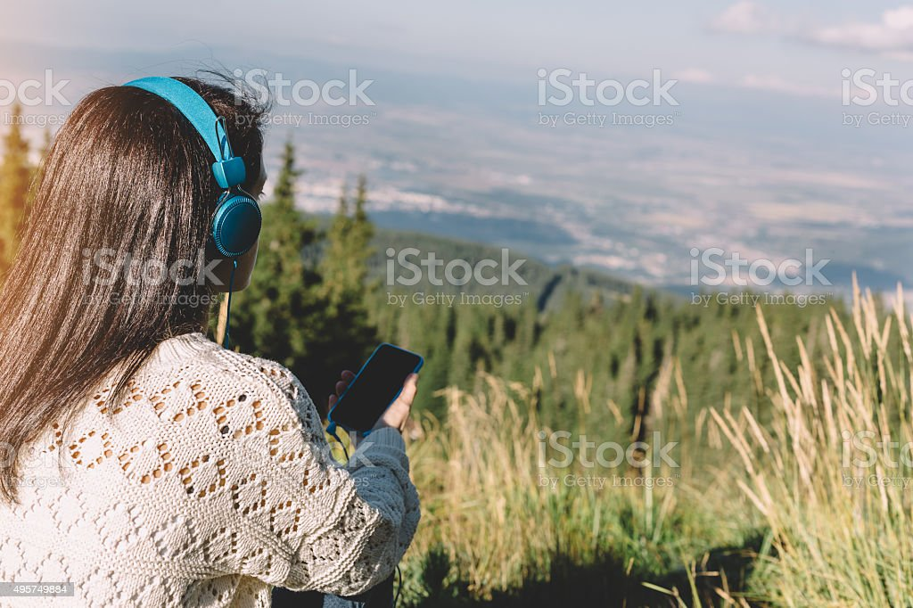 Woman relaxing in the mountain stock photo