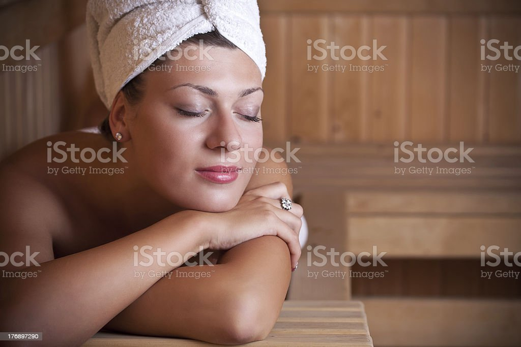 Woman relaxing in the sauna stock photo