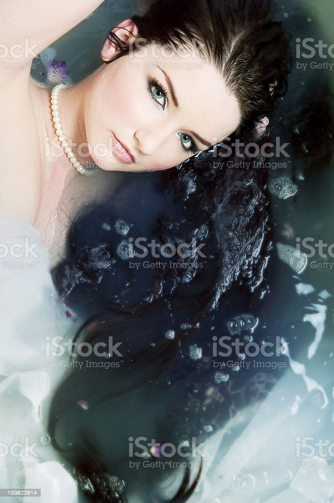Woman relaxing in water stock photo