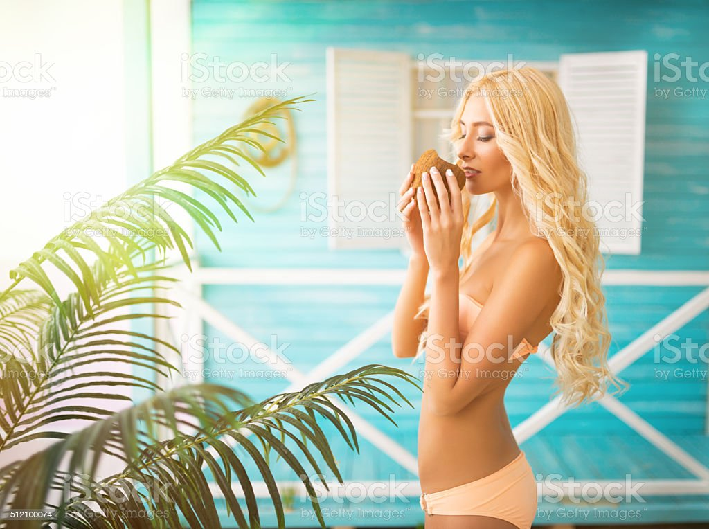 Woman relaxing near bungalows stock photo