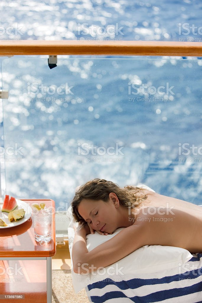woman relaxing on a balcony royalty-free stock photo