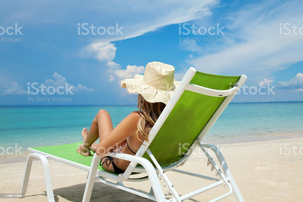 Woman relaxing on a beach royalty-free stock photo