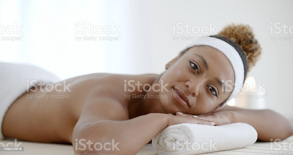 Woman Relaxing On A Pillow stock photo