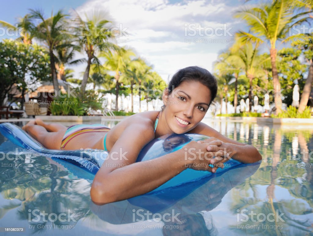 Woman relaxing on a Pool Raft royalty-free stock photo