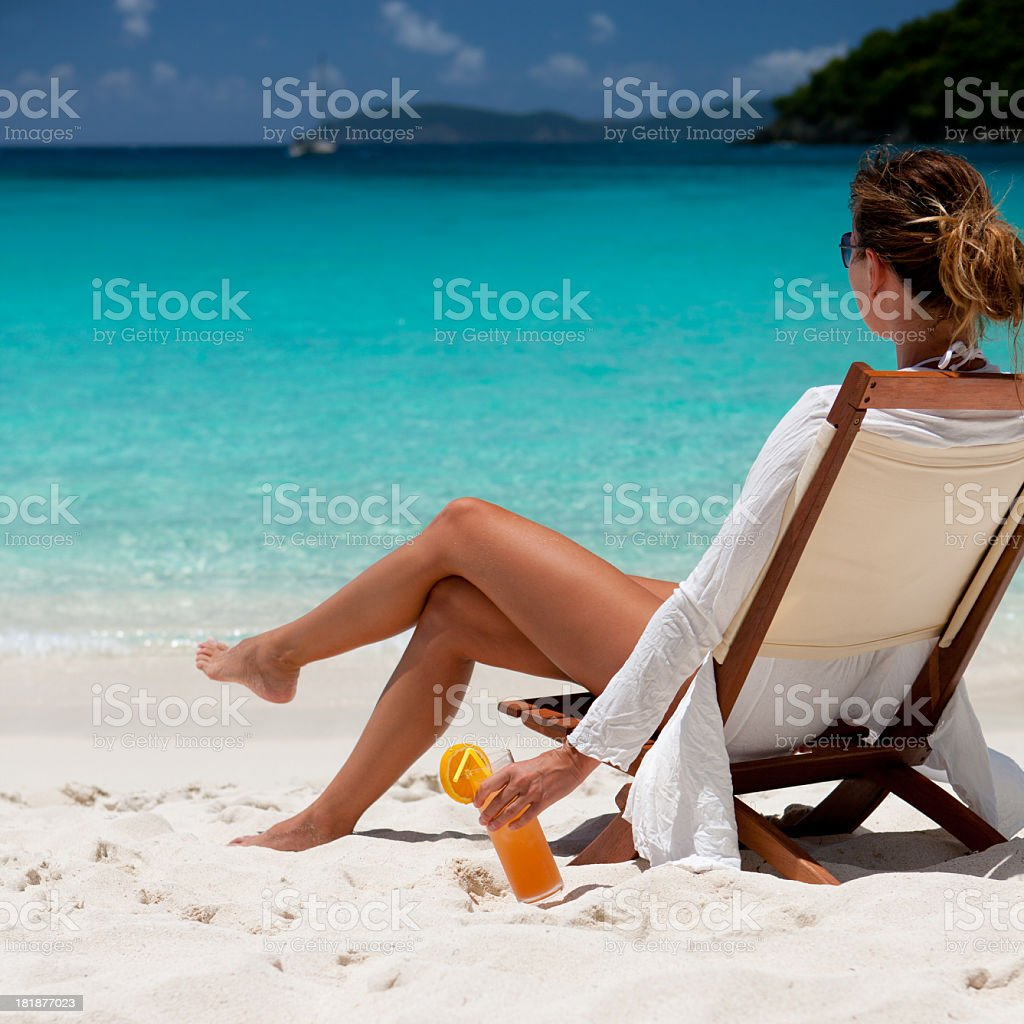 Woman relaxing on beach in the Caribbean royalty-free stock photo