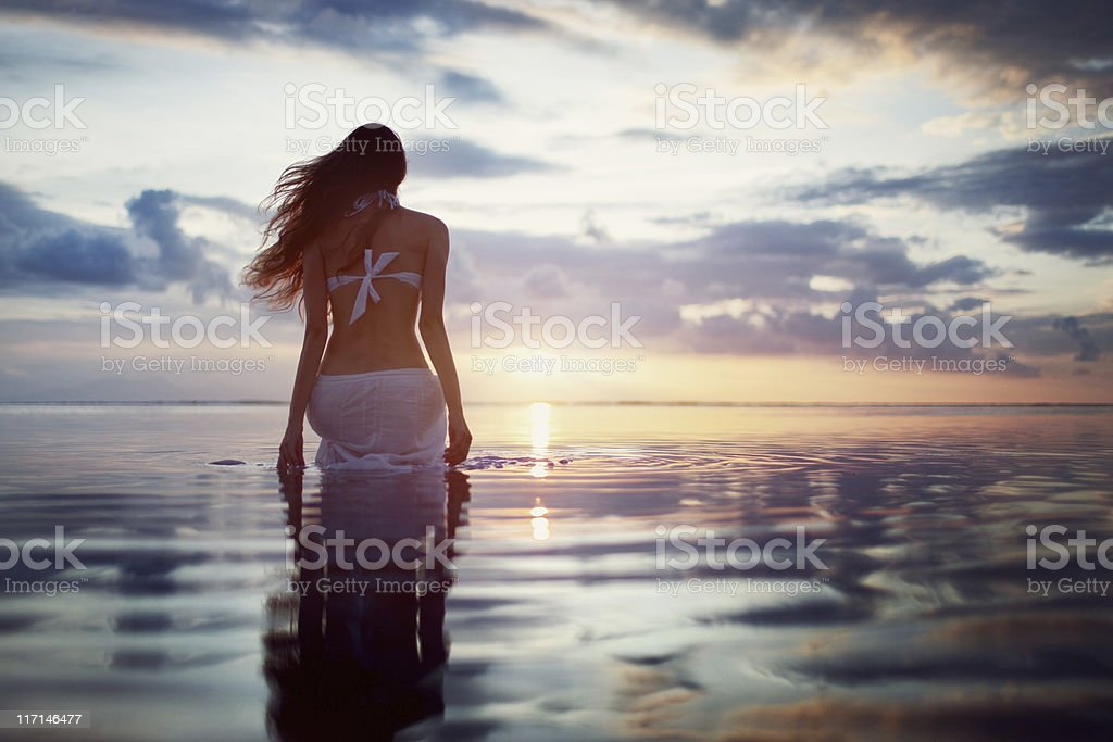 Woman Relaxing on Beach royalty-free stock photo
