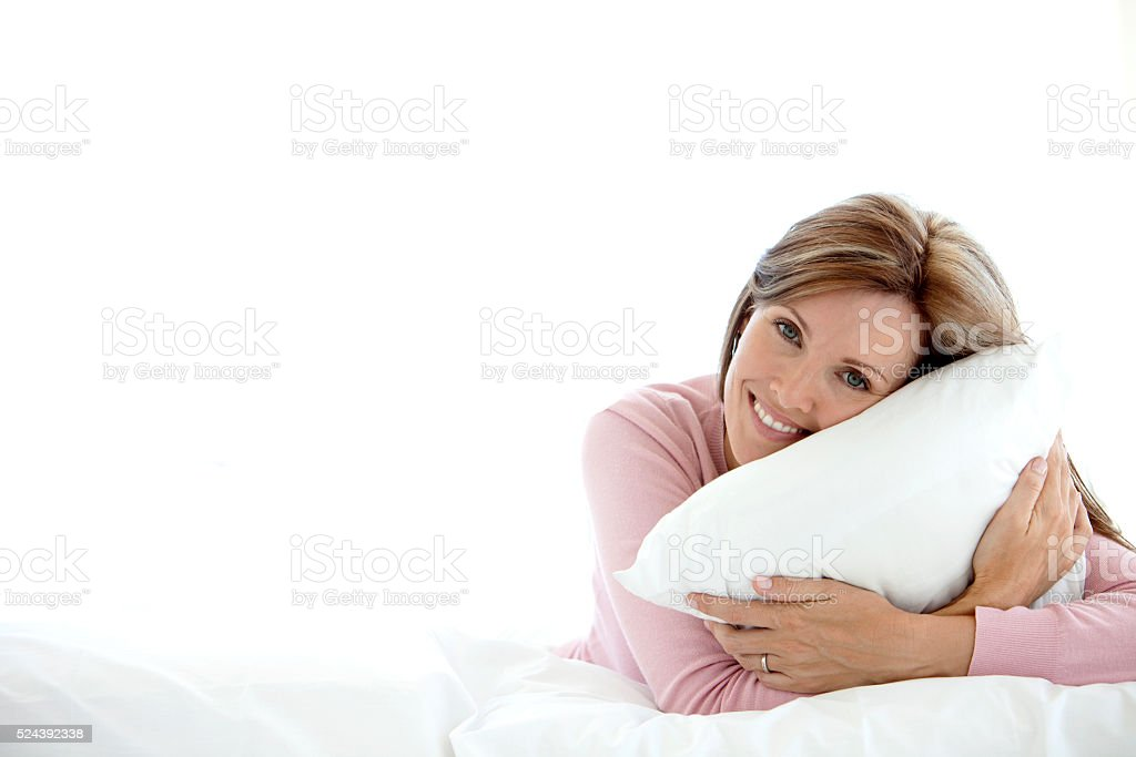 Woman relaxing on bed stock photo