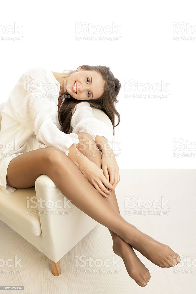 Woman relaxing on chair stock photo