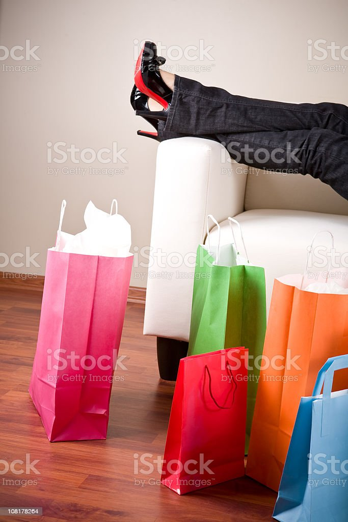 Woman Relaxing on Couch after Shopping royalty-free stock photo
