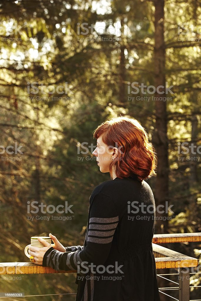 Woman relaxing on deck in nature royalty-free stock photo