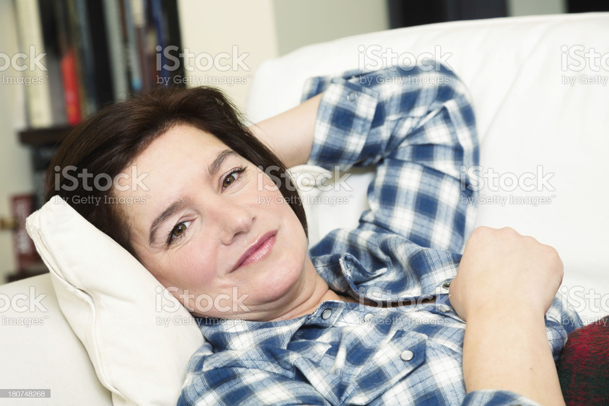 Woman relaxing on her couch royalty-free stock photo