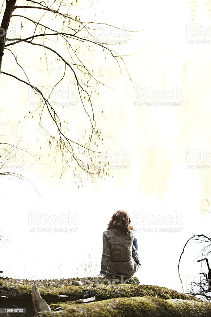 Woman relaxing on log in nature royalty-free stock photo