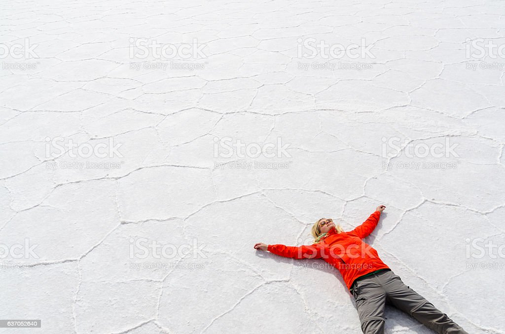 Woman relaxing on Salar de Uyuni stock photo