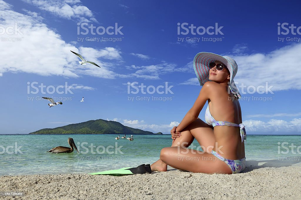 Woman relaxing on the beach island of Roatan royalty-free stock photo