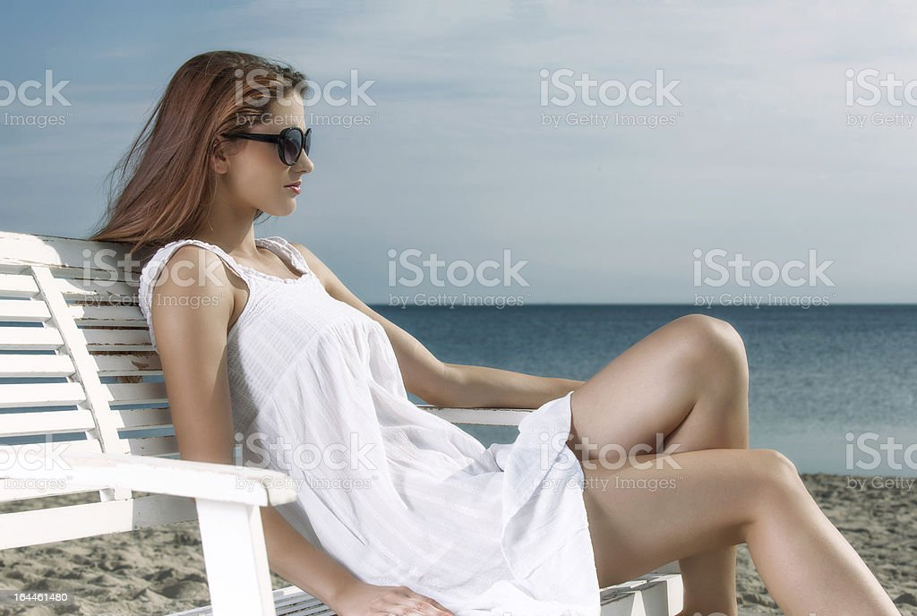 Woman relaxing on the beach royalty-free stock photo