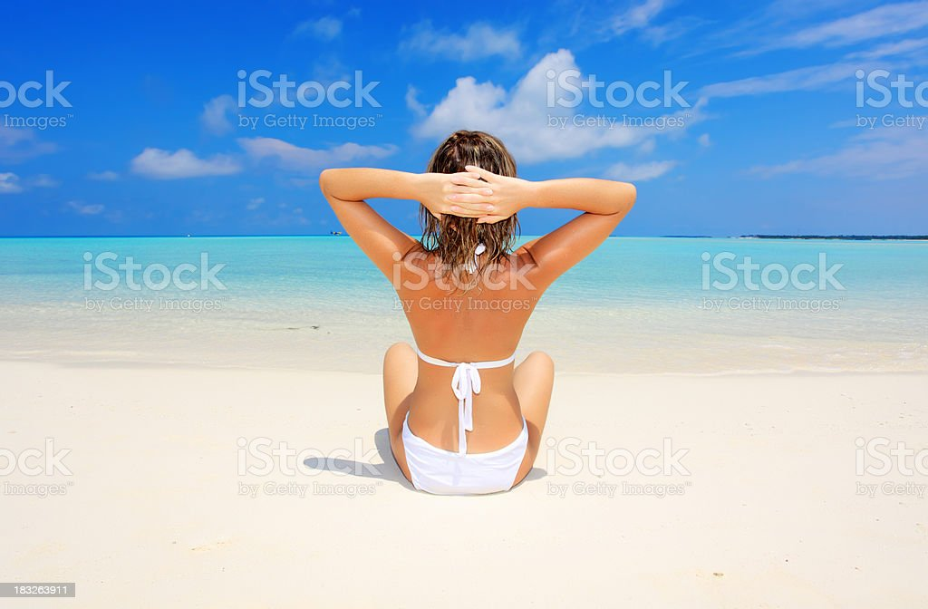 Woman relaxing on the beach. royalty-free stock photo