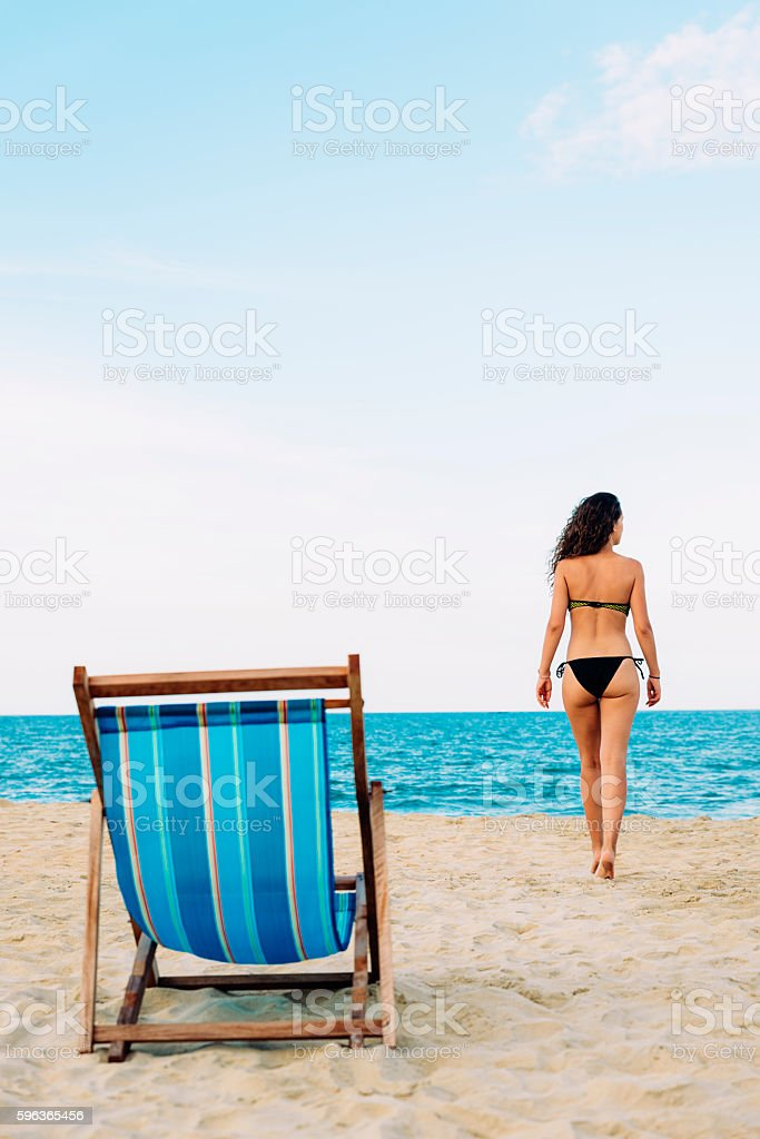 Woman Relaxing On The Beach. stock photo