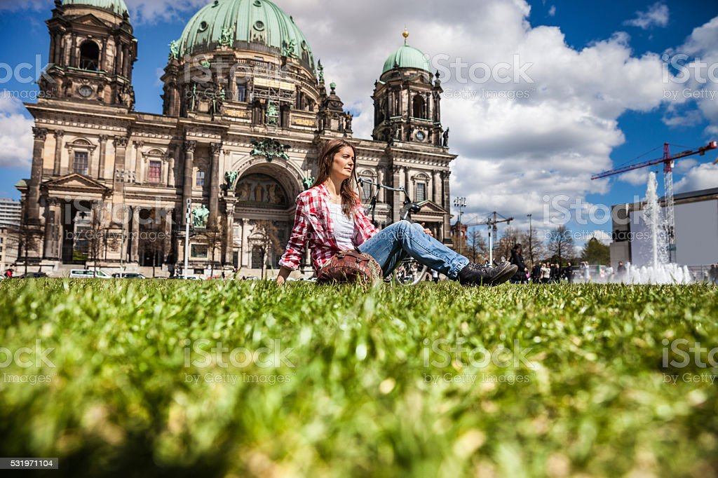 Woman relaxing on the grass in Berlin stock photo
