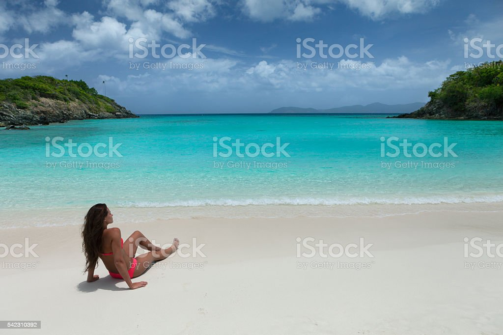 Woman relaxing on tropical beach in the Caribbean stock photo
