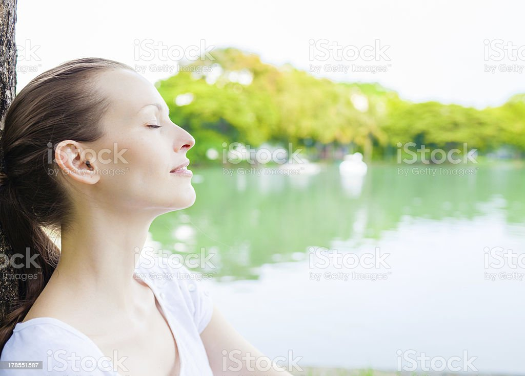 woman relaxing outdoors stock photo
