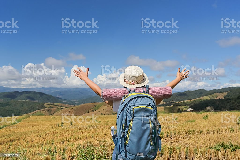 Woman relaxing travel on mountains and enjoying on time stock photo