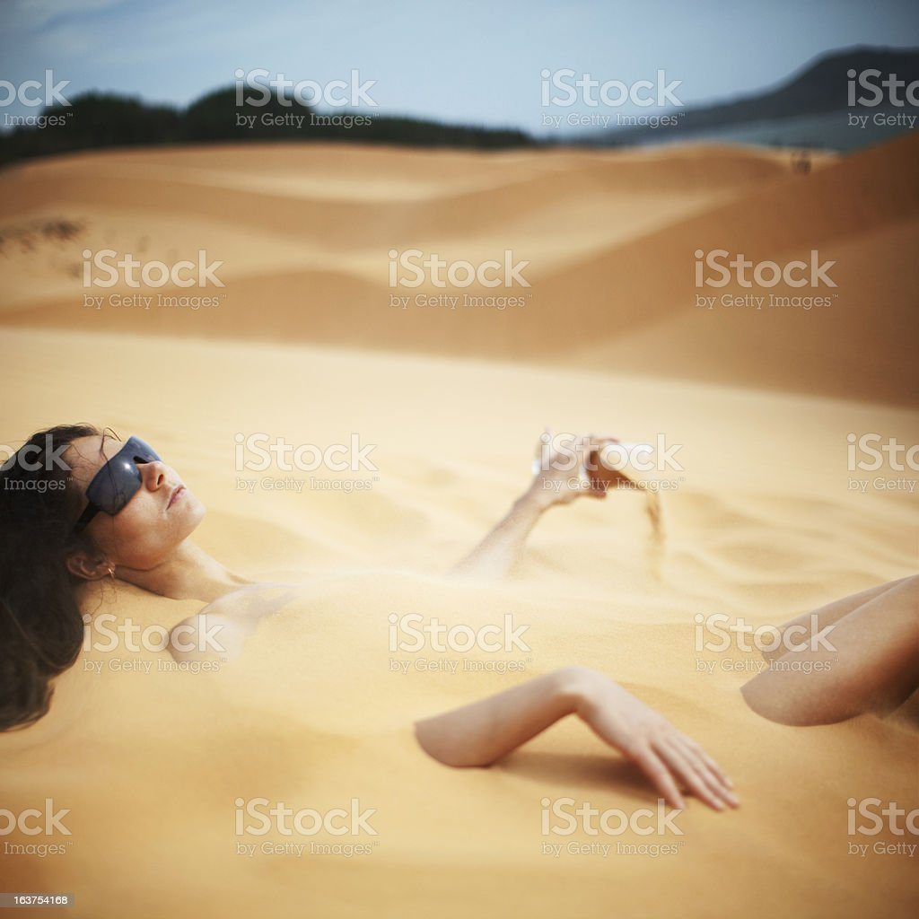 Woman Relaxing Under The Sun royalty-free stock photo