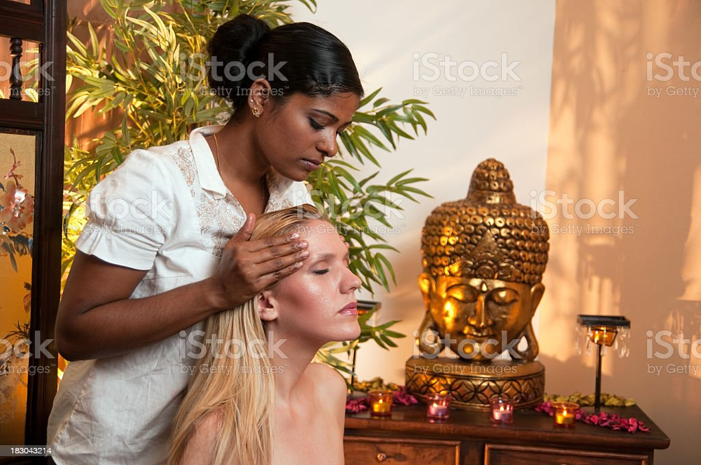 Woman relaxing while receiving Ayurveda massage stock photo