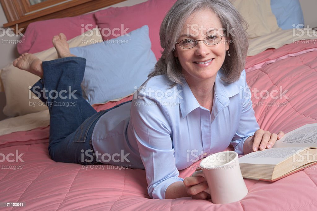 Woman relaxing with coffee and book (XXL) royalty-free stock photo