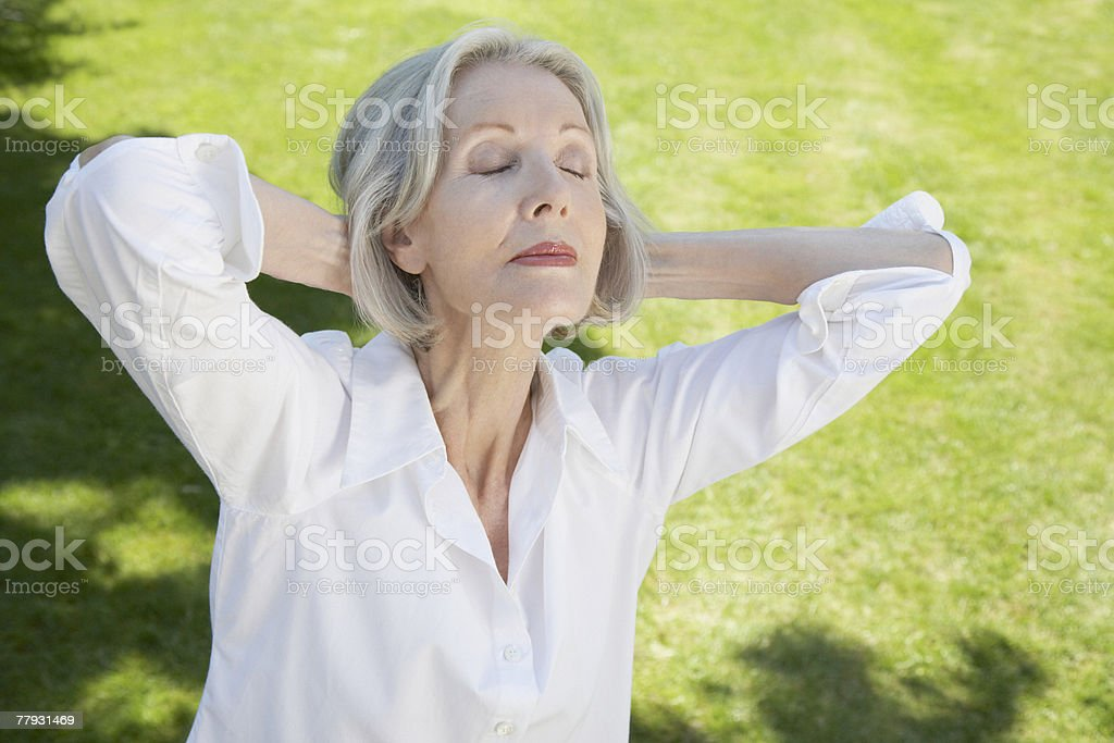 Woman relaxing with hands on neck outdoors royalty-free stock photo