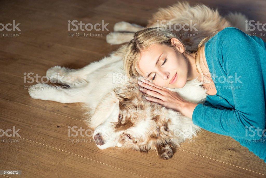 Woman relaxing with her Australian Shepherd Dog stock photo