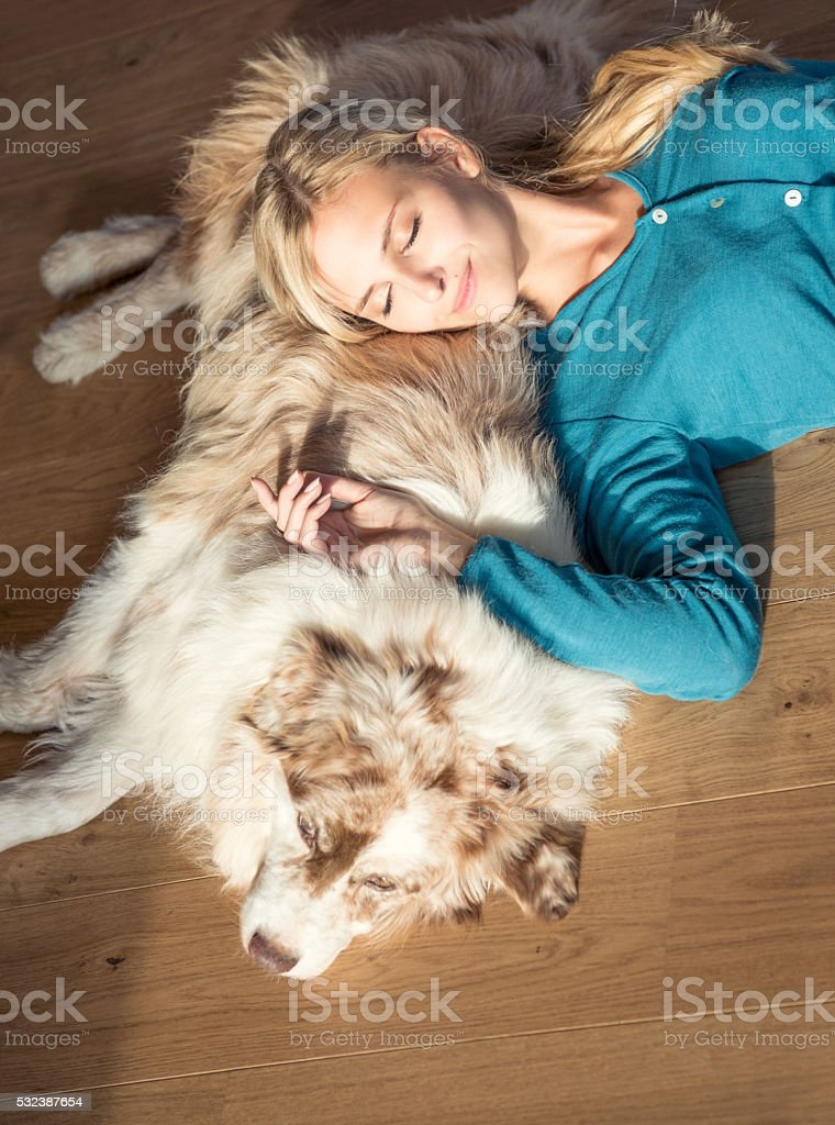 Woman relaxing with her Dog stock photo