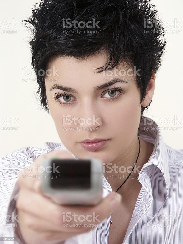 woman & remote control (vertical) royalty-free stock photo