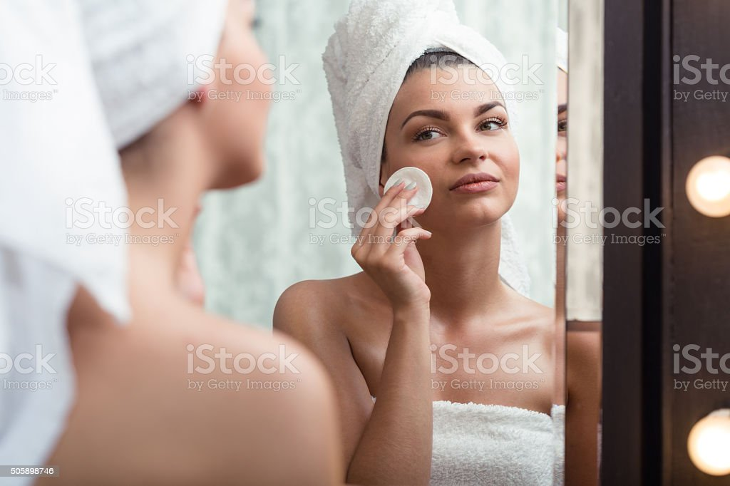 Woman removing makeup stock photo