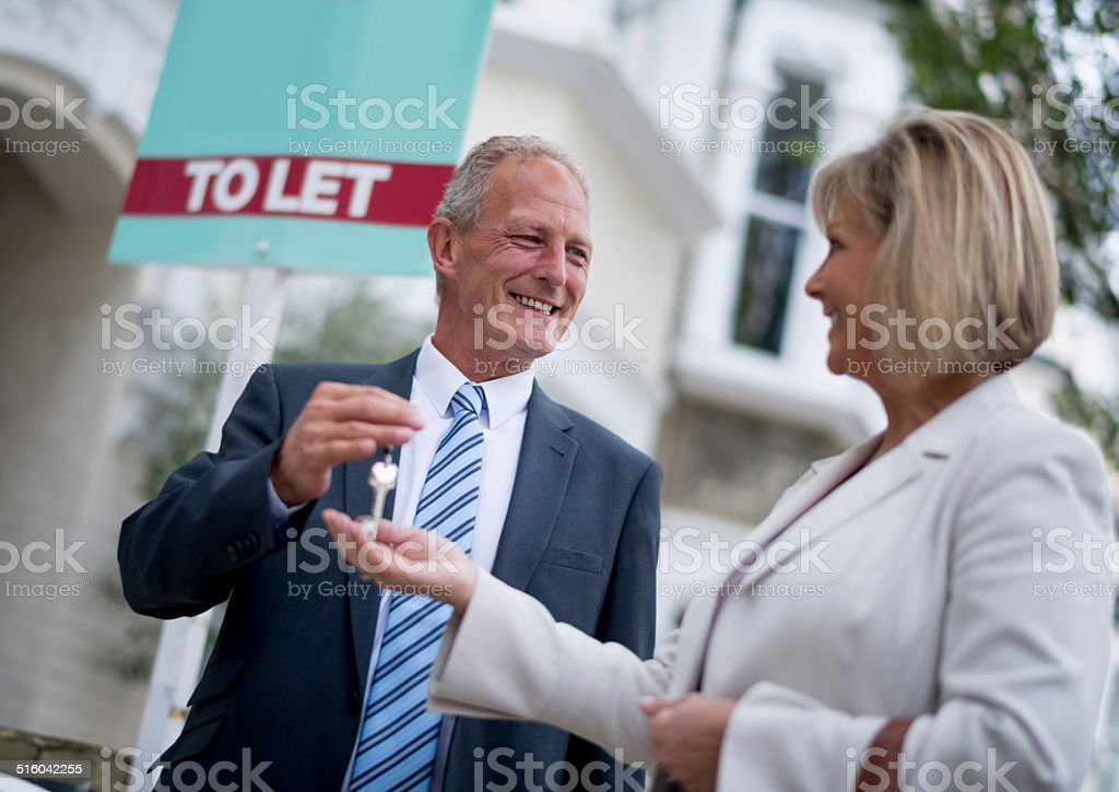 Woman renting a house stock photo