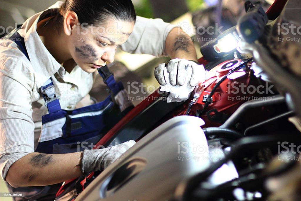 Woman repair cars stock photo