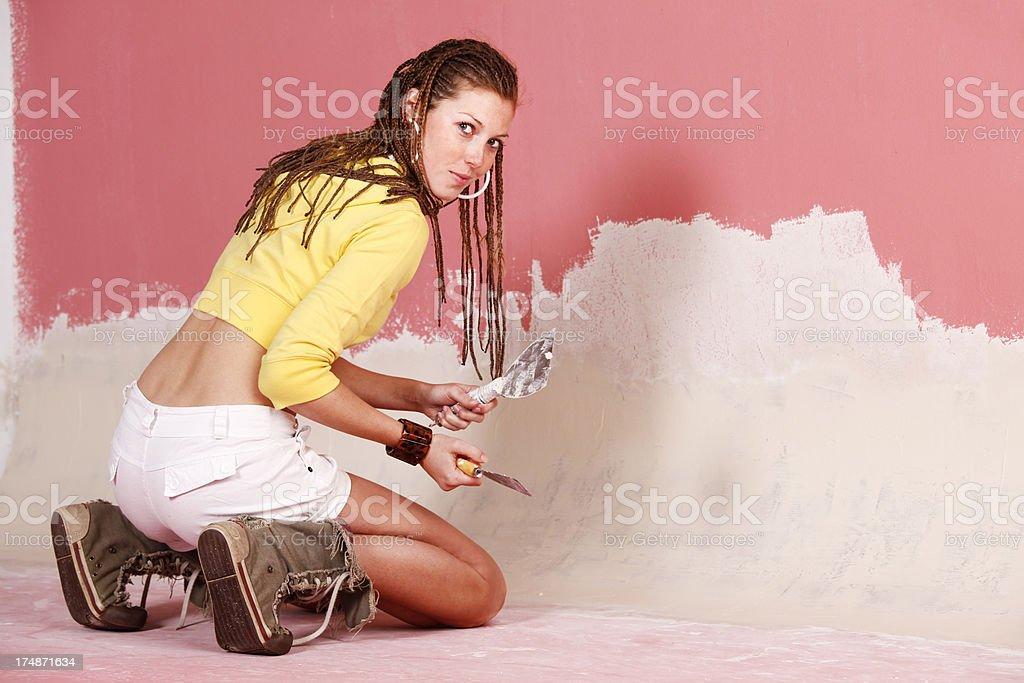 Woman reparing the wall stock photo