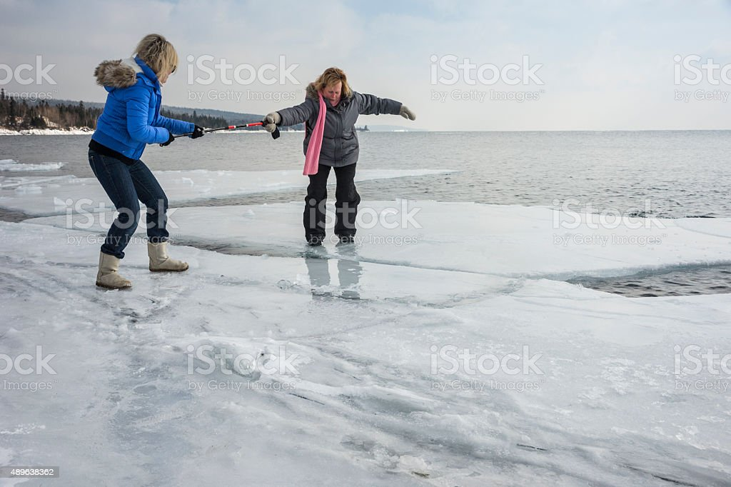 Woman rescues another woman from floating away on Lake Superior stock photo