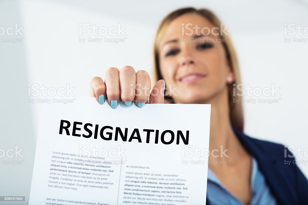 woman resigning with a smile on her face stock photo