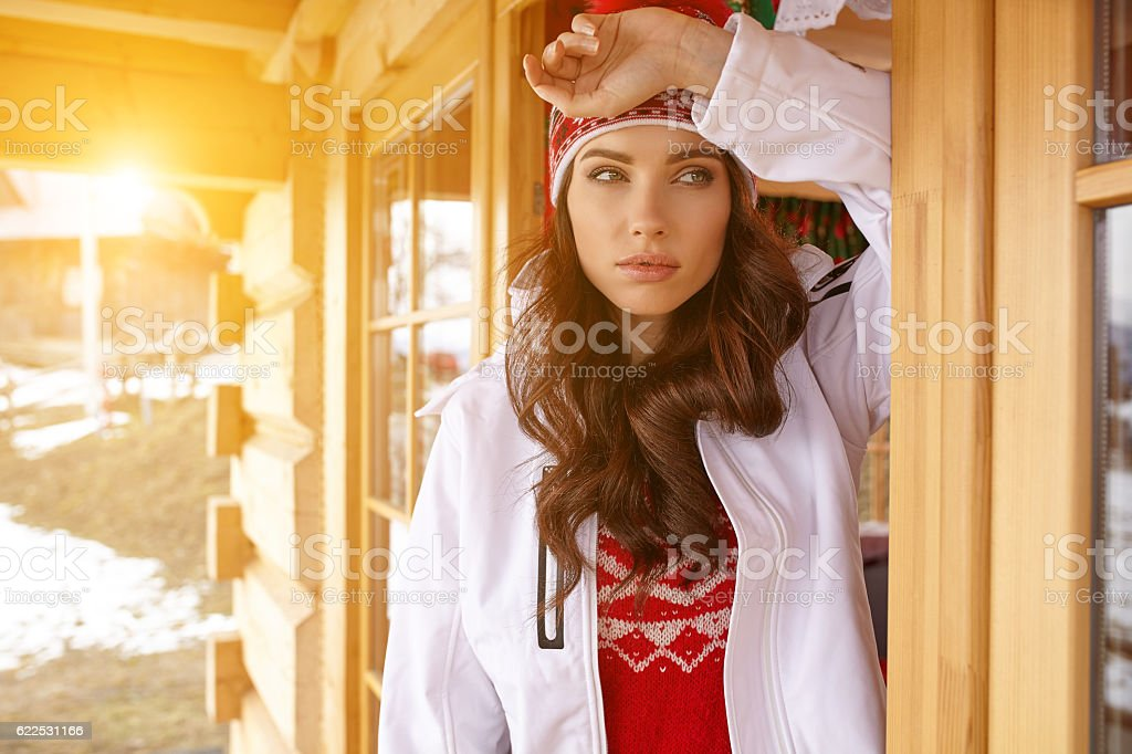 woman resting after a winter sports on the terrace of stock photo