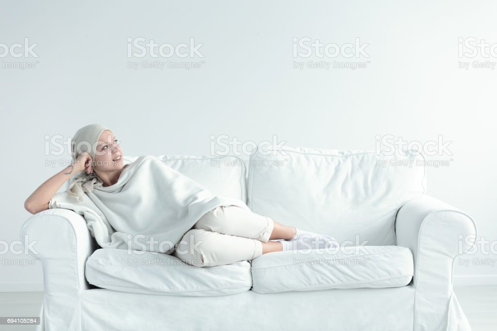 Woman resting after chemo stock photo
